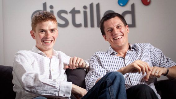 Will Critchlow and Duncan Morris sitting on sofa together smiling Interviews in Search   Will Critchlow